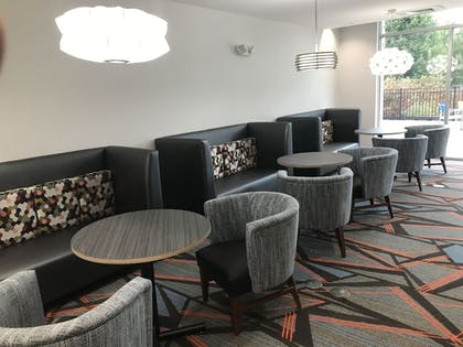 Lobby Sitting Area | Holiday Inn Express & Suites Greenville SE - Simpsonville