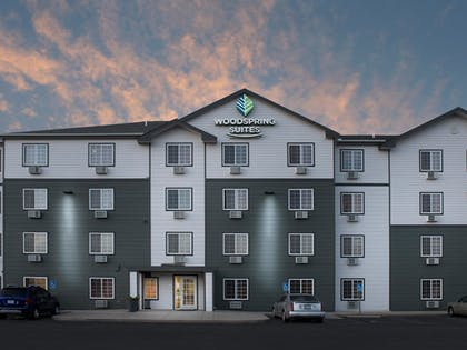 Hotel Front - Evening/Night | WoodSpring Suites Wichita North