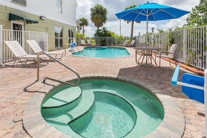 Outdoor Pool | Days Inn & Suites by Wyndham Fort Pierce I-95