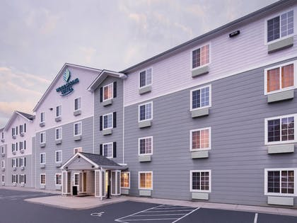 Hotel Front - Evening/Night | WoodSpring Suites Fayetteville