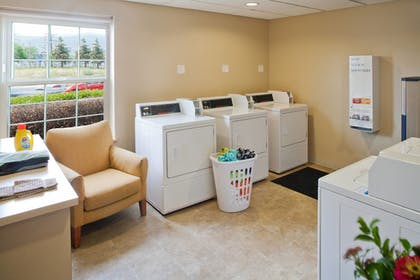 Laundry Room | TownePlace Suites by Marriott Medford