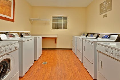 Laundry Room | Candlewood Suites Olive Branch