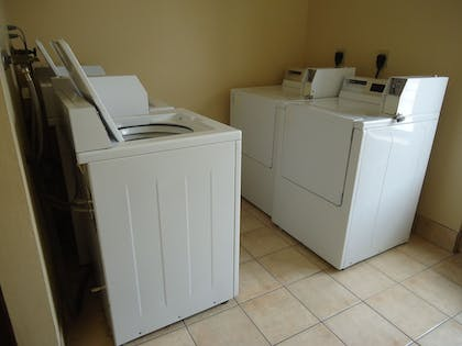 Laundry Room |  | Town House Extended Stay Hotel Downtown