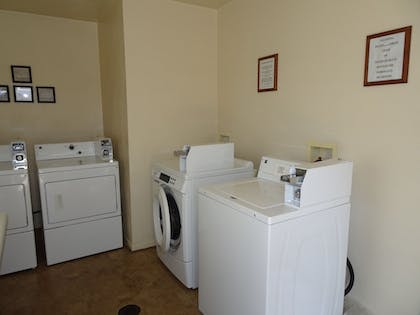 Laundry Room | Affordable Corporate Suites
