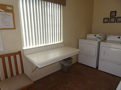 Laundry Room | Affordable Corporate Suites - Lanford