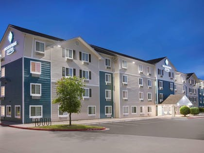 Hotel Front - Evening/Night | WoodSpring Suites Indianapolis Lawrence