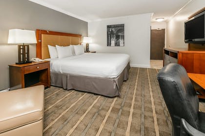 Guestroom |  | Richmond Inn & Suites Trademark Collection by Wyndham