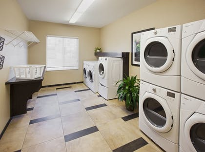 Laundry Room | Candlewood Suites Farmers Branch