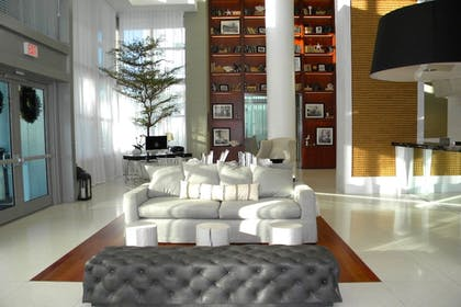 Lobby Sitting Area | Suite Life Miami at The Monte Carlo