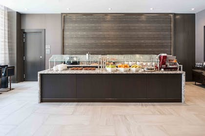 Breakfast Area | AC Hotel by Marriott Boston Cleveland Circle