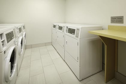Laundry Room | TownePlace Suites by Marriott Louisville Northeast