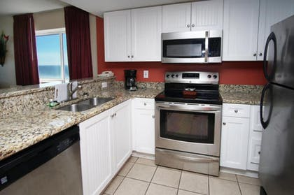 In-Room Kitchen | Camelot by the Sea by Elliott Beach Rentals