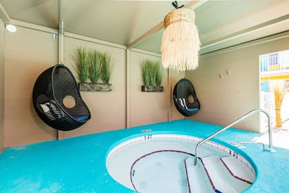 Outdoor Spa Tub | Waikiki Village Retro Motel by Oceana Resorts
