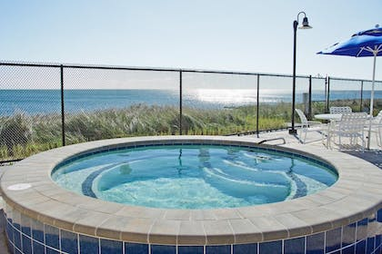 Outdoor Spa Tub | Ocean Mist Beach Hotel & Suites