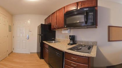 In-Room Kitchen | Candlewood Suites Houston Westchase/ Westheimer.
