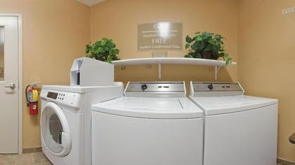 Laundry Room | Candlewood Suites Houston Westchase/ Westheimer.