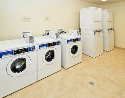 Laundry Room | TownePlace Suites by Marriott Houston North / Shenandoah