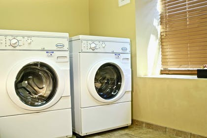Laundry Room | AmericInn by Wyndham Fargo Medical Center