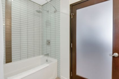Bathroom Shower | 1010 WILSHIRE SERVICED APTS