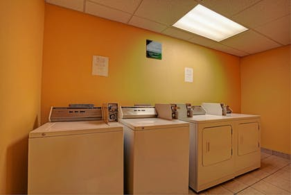 Laundry Room | Magnolia Inn and Suites Olive Branch