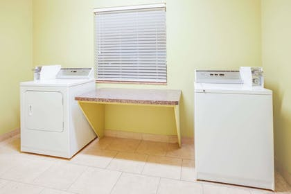 Laundry Room | Days Inn & Suites by Wyndham Russellville