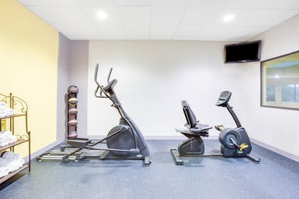 Fitness Facility | Days Inn & Suites by Wyndham Russellville