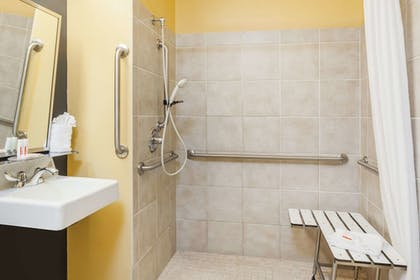 Bathroom Shower | Microtel Inn & Suites by Wyndham Dickson City/Scranton