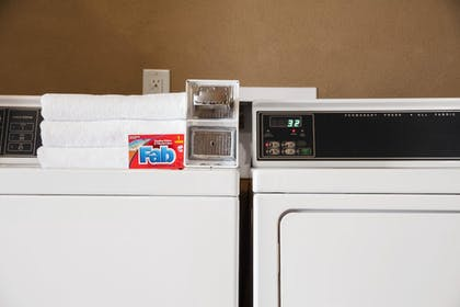 Laundry Room | Days Inn & Suites by Wyndham Houston North-Spring