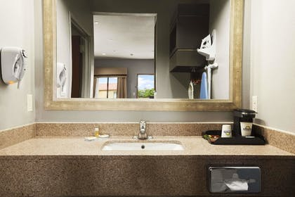 Bathroom Sink | Days Inn & Suites by Wyndham Houston North-Spring