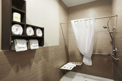 Bathroom | Days Inn & Suites by Wyndham Houston North-Spring