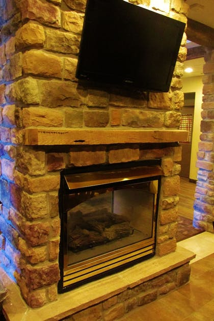 Fireplace | Crystal Springs Inn and Suites